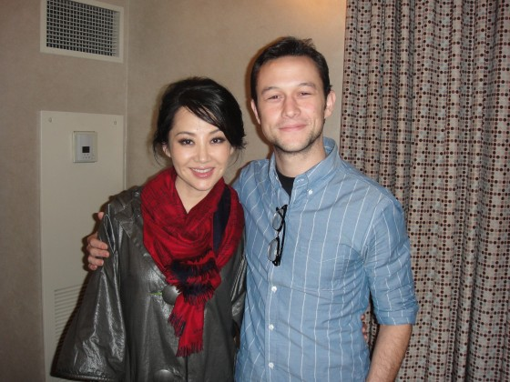 Summer Qing and Joseph Gordon-Levitt star in Looper 2102.