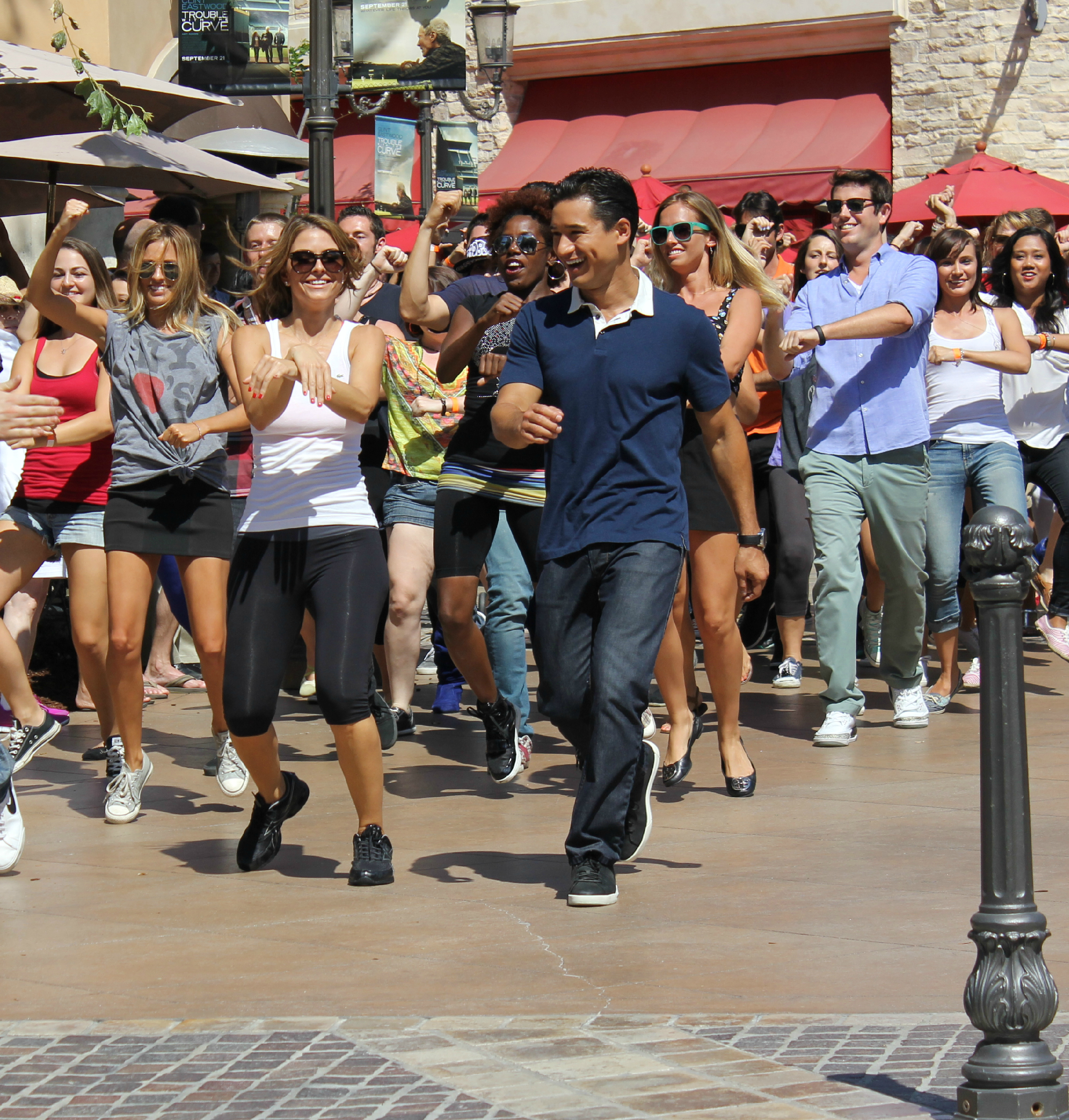 Maria Menounos and Mario Lopez lead Psy's Gangnam Style flash mob