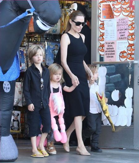 Angelina Jolie Halloween costume shopping with the kids