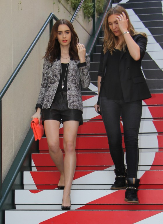Lily Collins Shows Off Toned Legs At Extra Appearance