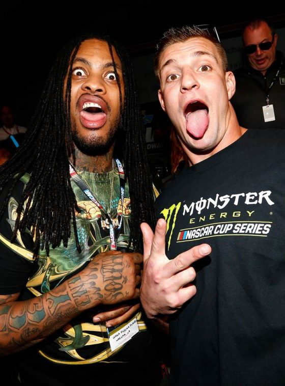 Rob Gronkowski and Waka Flocka Flame pose in the drivers meeting before the DAYTONA 500