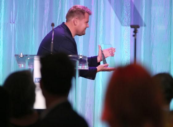 Presenter James Corden presents The Gil Nickel Humanitarian Award to honorees Yael and Scooter Braun