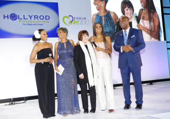 PACIFIC PALISADES, CA - JULY 15:  (L-R) Singer Terry Ellis, Dolores Robinson, host Holly Robinson Peete, Matthew T. Robinson Award of Courage recipient Linda Ronstadt  and host Rodney Peete speak onstage at HollyRod Foundation's DesignCare Gala on July 15, 2017 in Pacific Palisades, California.  (Photo by Tiffany Rose/Getty Images for HollyRod Foundation)