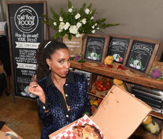 Shanola Hampton enjoying amazing gluten free pizza from Cali'flour Foods