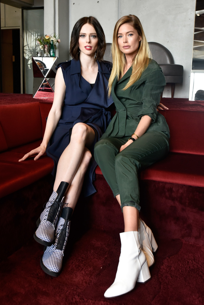Models Coco Rocha (L) and Doutzen Kroes visit the Etihad VIP Lounge during IMG NYFW: